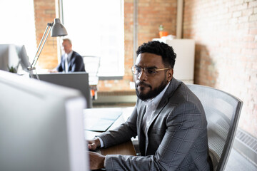 Focused businessman working at computer in office