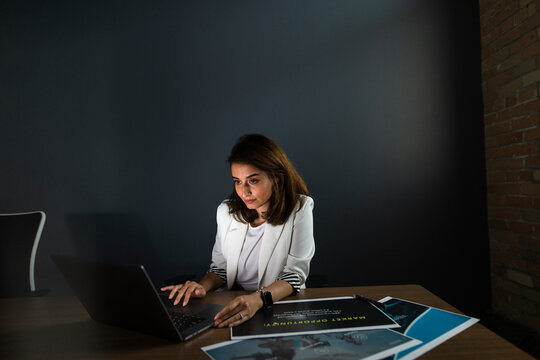 Businesswoman working late at laptop in office