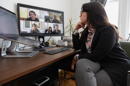 Woman having online meeting in home office
