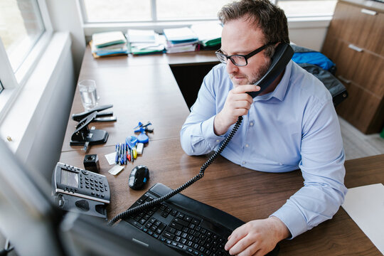 Mature man on phone in office