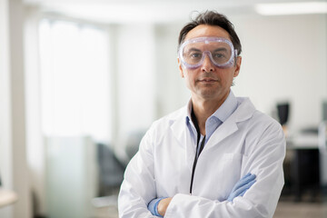 Portrait of medical researcher wearing protective goggles