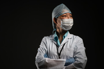 Portrait of medical researcher wearing protective cap and face mask