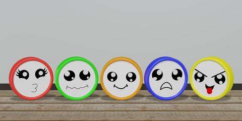 Bunte Emoticons in verschiedenen Stimmungen auf Holzboden.