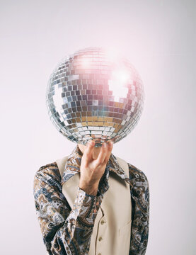 1970s Disco man in a leisure suit with a glittering disco mirror ball for a head