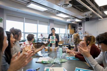 High school teacher and students working on climate change project