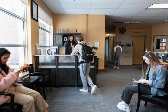 High school students waiting in school office