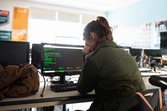 High school girl student using computer in classroom