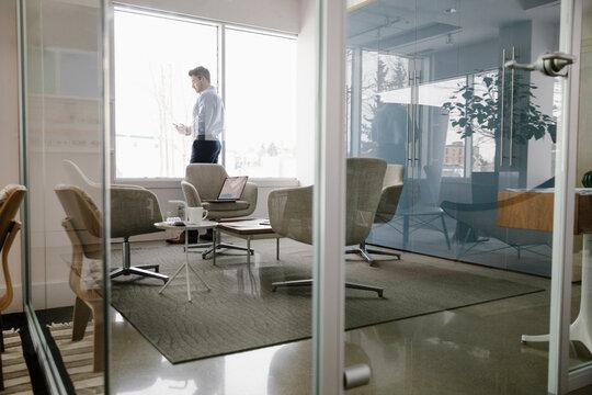 Businessman using phone in modern office