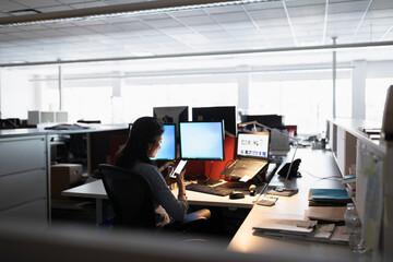 Woman using phone at desk