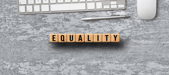cubes with message EQUALITY with office equipment on concrete background