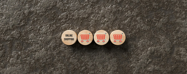 wooden cylinders with message ONLINE SHOPPING and shopping cart icons on a wet sidewalk