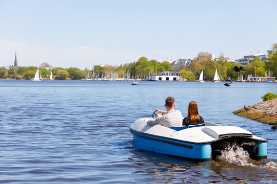 happy couple in pedal boat at Aussenalter, Hamburg