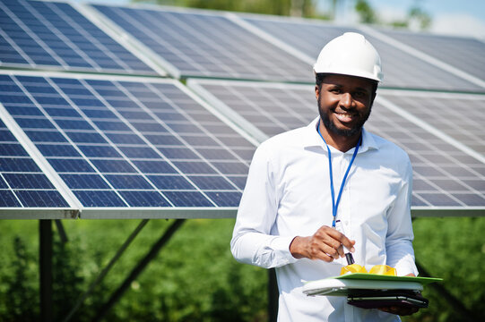 African american technician check the maintenance of the solar panels. Black man engineer at solar station.