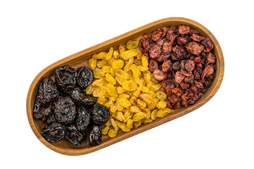 Fototapete - Top view of various kinds of dried fruit in a wooden tray on white background with clipping path.