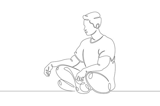 young man meditates relaxes in lotus position
