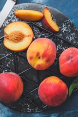 Tasty ripe peaches on table