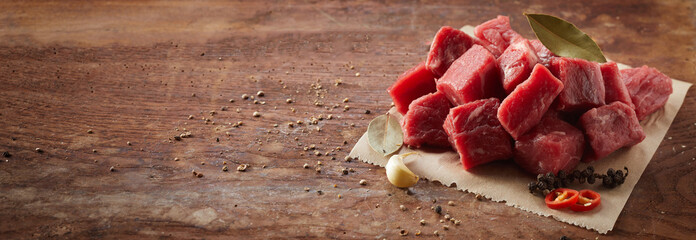 Rustic panorama banner with fresh diced beef
