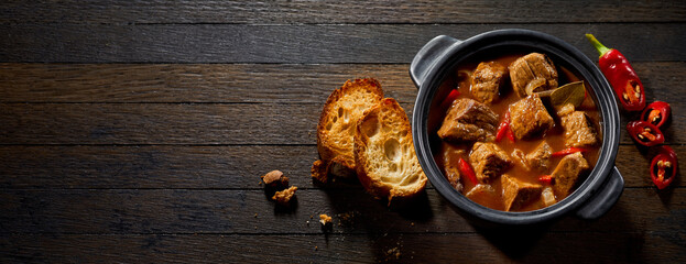 Pot if tasty German ragout with toasted baguette