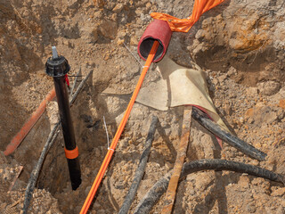 Construction trench with electrical wires. Road work