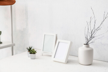 Photo frames on table in room
