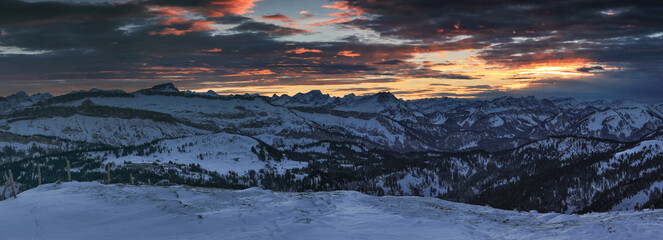 Wall Mural - Amazing sunset alpenglow panorama view to snow covered mountain ranges and dramatic sky in cold winter. View from Riedberger Horn to Allgau Alps Mountains, Ifen and Austria. Bavaria, Germany.