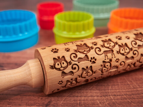 Colorful cookie cutters and embossed rolling pin