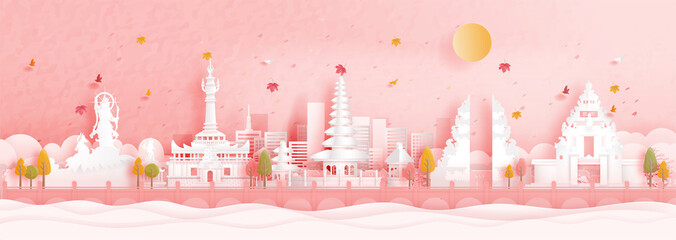 Fototapete - Autumn in Denpasar, Bali. Indonesia with falling maple leaves and world famous landmarks in paper cut style vector illustration