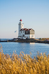 Canvas Prints Horses View of Paard van Marken lighthouse, Netherlands, Waterland district near Amsterdam, popular travel destination and tourist attraction. Autumn, fall concept