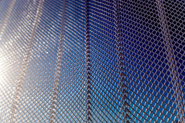 net made of nylon protects a summer window from mosquitoes and insects, close up detail.