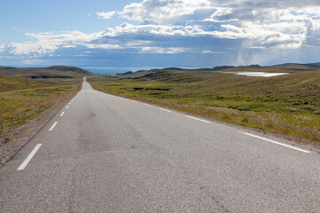 The twisting road through the polar tundra to the Barents Sea, Finnmark, Norway