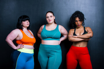 Plus size women making sport and fitness.