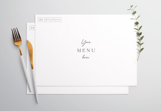 Menu on Table with Cutlery and Eucalyptus Mockup