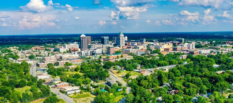 Aerial shot of the skyline of Greensboro located in North Carolina, USA, on a partly cloudy day
