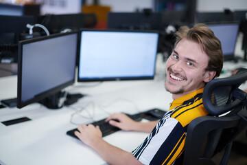 casual business man working on desktop computer
