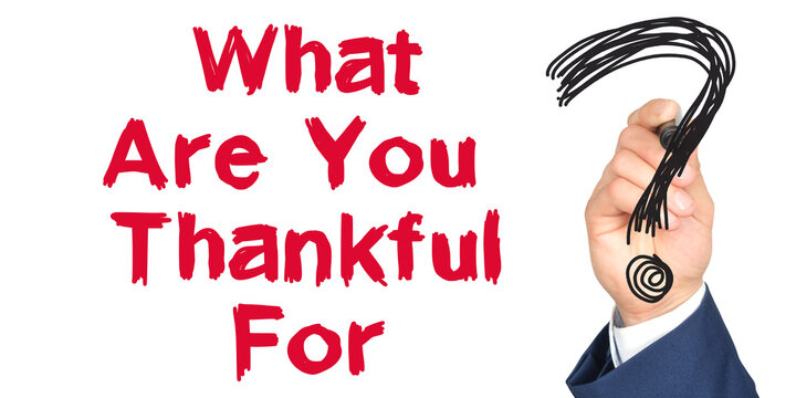 Hand with marker writing: What Are You Thankful For