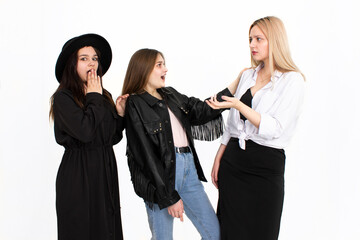 Three girls are discussing something with each other