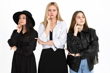 Three young beautiful girls are thinking about solving the problem