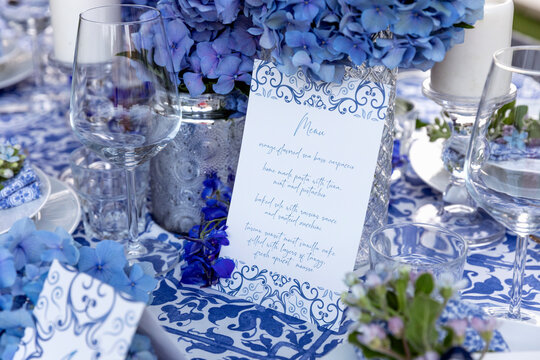 Banquet menu near decorations on table