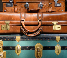 Pile of old vintage luggage close up