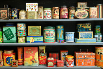 Display of colorful vintage cans on a shelf