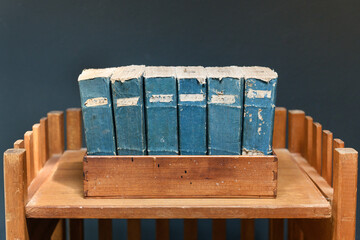 Set of old worn and tattered vintage books