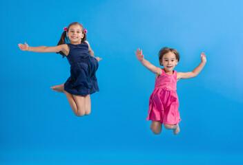 Little Happy Children Girls Jumping And Having Fun