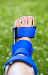 Foot ankle recovery, stabilizing with support brace after a sport accident