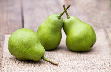 Fresh green healthy fruit pears on a wooden table