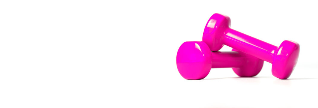 Banner of fitness concept with pink dumbbells, and a bottle of water, on a white background.