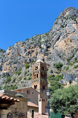 Moustiers-Sainte-Marie at the foot of the mountain and church of Notre-Dame-de-l'Assomption. Moustiers-Sainte-Marie is a commune in the Alpes-de-Haute-Provence department in southeastern France