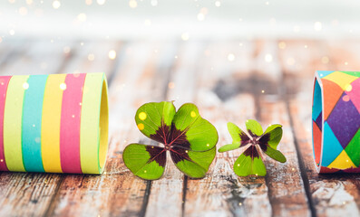 shamrock on wooden background with streamers
