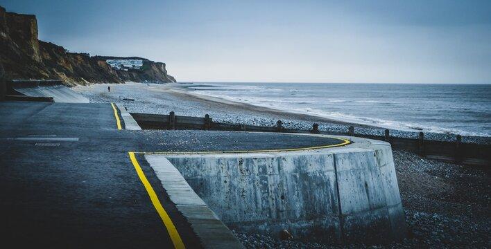 Scenic view of the seashore near a road