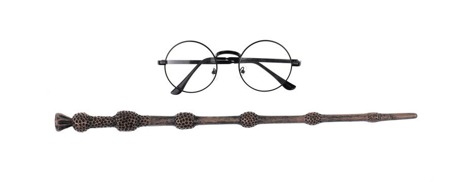magic wand and glasses of magician isolated on white background