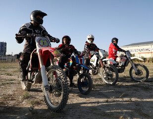 Members of a motocross team get ready before a training in Kabul